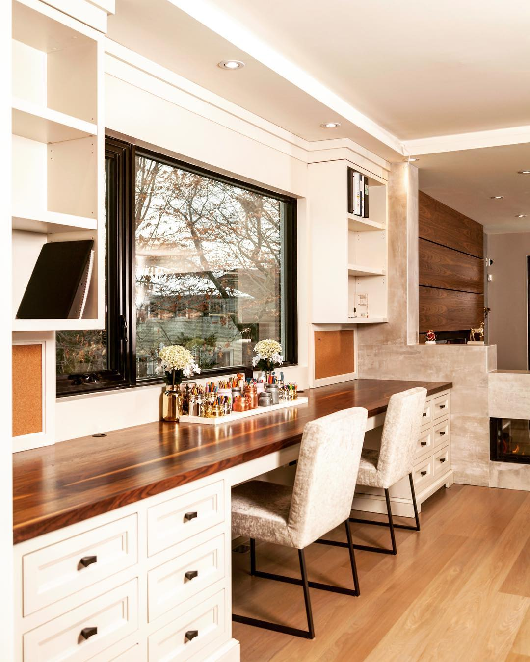 Dreamy office with lots of counter space and storage to keep organized and clean this beautiful desk features white cabinets shelves and a pop of wood